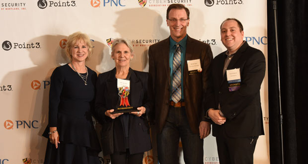 Ellen Hemmerly, second fron left, the executive director, bwtech@UMBC, accepts the Champion of the Year Award during the second annual Maryland Cybersecurity Awards event March 27 at the American Visionary Art Museum in Baltimore. Joining Hemmerly on stage were, from left, Gina Abate, the Cybersecurity Association of Maryland board char; Michael Ryan, the CEO of South River Technologies; and Evan Dornbush, co-founder and CEO of Point3 Technologies. – Ellen Hemmerly, Executive Director, bwtech@UMBC [presented and sponsored by South River Technologies]