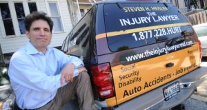 """06.02.2011 BALTIMORE, MD- Steven H. Heisler, and his """"Injury Law Mobile"""", a Ford Expedition that he had wrapped with advertising for his Law Firm. (The Daily Record/Maximilian Franz)."""