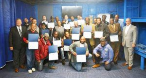 Graduates from the Herbert J. Hoelter Vocational Training Center display their certificates after the March 13 ceremony in Baltimore. (Submitted photo)