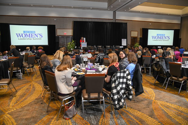A crowd of more than 130 guests listen to remarks from Suzanne Fischer-Huettner, publisher of The Daily Record, during the Women's Leadership Summit at the BWI Hilton. (Photo by Maximilian Franz / The Daily Record)