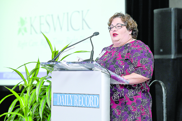 Maria Johnson Darby, the vice president of communications and external relations with Keswick, speaks to the audience at the Women's Leadership Summit at the BWI Hilton. Keswick is the Path to Excellence and summit series sponsor. (Photo by Maximilian Franz / The Daily Record)