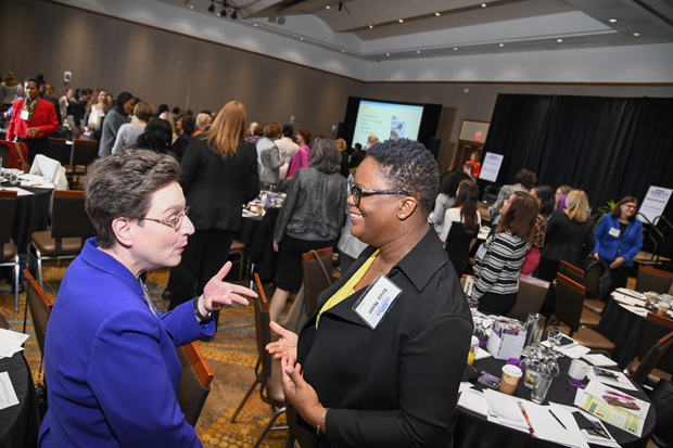 Theresa Wiseman, left, president of MediaWise Inc., spends some time getting to know Kevia Moore, a senior recruiting specialist with MECU Credit Union, during a break in the Women's Leadership Summit. (Photo by Maximilian Franz / The Daily Record)