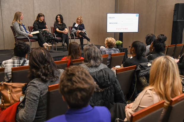 "On stage from left, Marybeth Hyland, founder of SparkVision; Kirsten Brinlee, executive director of Baltimore Collegetown Network; Veronica Cool, managing partner of Cool & Associates LLC; and Barb Clapp, president and CEO of Clapp Communications, engage with guests during the ""Narrowing the Generational Guide"" panel discussion during the Women's Leadership Summit. (Photo by Maximilian Franz / The Daily Record)"
