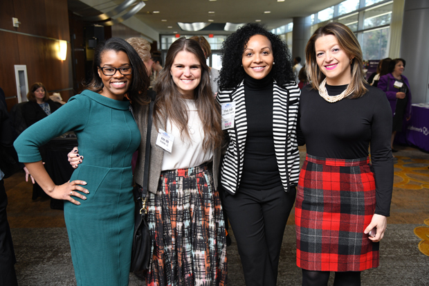 Kara Beverly, an attorney and equity compliance investigator with Johns Hopkins University; Anne Hilb, an independent consultant with Graymake LLC; Tiffany Ester, a global supply chain manager with Northrop Grumman Corp.; and Oana Brooks, an attorney and equity compliance investigator with Johns Hopkins University, take time for a photo during the Women's Leadership Summit. (Photo by Maximilian Franz / The Daily Record)