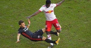 D.C. United's Paul Arreola, left, and Red Bulls' Kemar Lawrence collide Sunday in the final game to be played at RFK Stadium in Washington, D.C. MUST CREDIT: Washington Post photo by John McDonnell