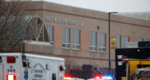 Deputies, federal agents and rescue personnel, converge on Great Mills High School, the scene of a shooting March 20 in Great Mills. (AP Photo/Alex Brandon)
