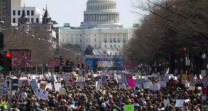 "Protesters stand Pennsylvania Avenue looking east toward the stage located near the Capitol during the ""March for Our Lives"" rally in support of gun control in Washington, Saturday, March 24, 2018. (AP Photo/Jose Luis Magana)"