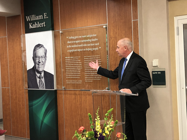 Dr. John B. Chessare, president and CEO of GBMC HealthCare, speaks the crowd as he presents the dedication plaque in the lobby of the William E. Kahlert Physicians Pavilion North building. (Photo by Eve Butt)