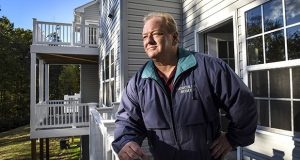 Gemcraft CEO Bill Luther on the deck of one of his unfinished houses. (Washington Post photo by Bill O'Leary)