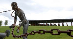 A statue of a chained man is on display at the National Memorial for Peace and Justice, a new memorial to honor thousands of people killed in racist lynchings in Montgomery, Alabama. The national memorial aims to teach about America's past in hope of promoting understanding and healing. It's scheduled to open on Thursday.  (Brynn Anderson/AP Photo)