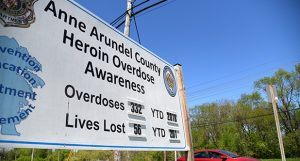A billboard designed to highlight public awareness in Anne Arundel County tracks the annual toll as of April 30, 2018: 332 overdoses and 56 deaths. (Maximilian Franz)