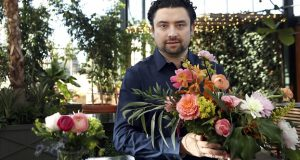 Shane Pliska, owner of Planterra, a commercial florist and owner of a wedding venue in West Bloomfield, Michigan, had to find flowers from Kenya when his usual South American suppliers were cut off by Hurricane Irma.(AP Photo/Carlos Osorio)