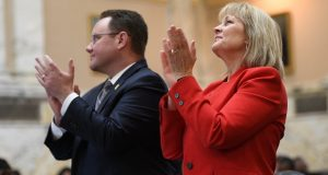 Del. Nicholaus Kipke, R-Anne Arundel, and Del. Kathy Szelia, R-Baltimore and Harford counties, applaud the final moments of the session. (Maximilian Franz)
