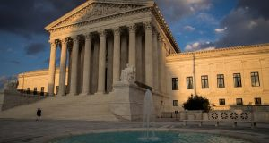 In this Oct. 10, 2017 photo, the Supreme Court in Washington is seen at sunset.  The Supreme Court is being asked to take a case about whether eye drops are too big. Don't roll your eyes. Major players in American's medicine cabinets are now asking the high court to take the case. On the other side are patients using the companies' drops to treat glaucoma and other conditions. They say wasted medication affects their wallets. They argue they should be able to sue. Drug companies, however, say the patients' argument is based on speculation and a bottle that doesn't exist.    (AP Photo/J. Scott Applewhite)
