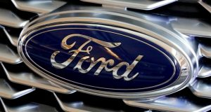This Feb. 15, 2018, file photo shows a Ford logo on the grill of a 2018 Ford Explorer on display at the Pittsburgh Auto Show. Ford Motor Co. reports earnings Wednesday, April 25. (AP Photo/Gene J. Puskar, File)
