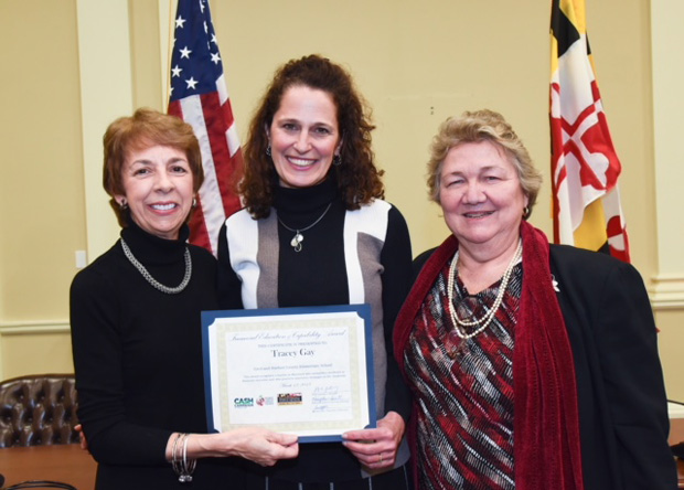 Dr. Lynne Gilli, left, assistant superintendent for the division of career and college readiness with the Maryland State Department of Education, gives the 2018 Financial Education & Capability Award for Elementary School Teacher or Program Award to Tracey Gay, center, of North Harford Elementary School. Joining them for the presentation is Mary Ann Hewitt, right, the executive director of the Maryland Council on Economic Education. (Photo by Richard Lippenholz)