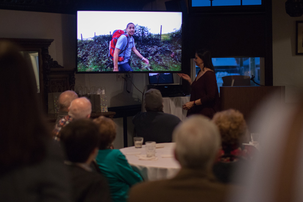 "Ida Heck, founder of Celebrate Hope, and attendees watch Al DeCesaris' film, ""Hiking Camino De Santiago for a Cure,"" which chronicles his 31-day hike across Spain to raise awareness and funds for Sturge-Weber Syndrome research. (Photo courtesy of Kennedy Krieger Institute)"
