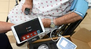10-27-2016 ELKTON, MD- Janet Maldonado, care transition nurse seen there training a patient, Frank Adams, how to use the  Union hospital Telehealth System, which monitors patient health from home and lower re-admission rates.  (The Daily Record/ Maximilian Franz).