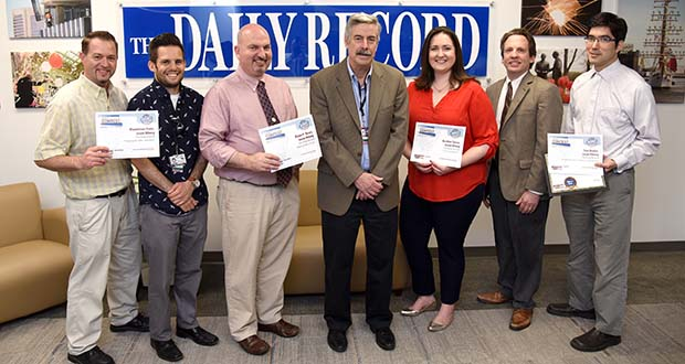 The Daily Record received 22 awards, including two Best of Show awards, in the Maryland Delaware District of Columbia Press Association's 2017 editorial, design and revenue contests. Standing with some of the award certificates are, from left, Maximilian Franz, Adam Bednar, Bryan P. Sears, Tom Baden, Heather Cobun, Steve Lash and Jason Whong.