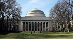 "In this April 3, 2017 file photo, students walk past the ""Great Dome"" atop Building 10 on the Massachusetts Institute of Technology campus in Cambridge, Mass. The Massachusetts Supreme Judicial Court ruled Monday, May 7, 2018, that MIT cannot be held responsible for the 2009 death of graduate student Han Nugyen who killed himself. His family's lawsuit said that the school knew he was a suicide risk and could have prevented his death. (AP Photo/Charles Krupa, File)"