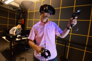 Some Mindgrub employees test a VR headset in the Mindgrub VR room. (Maximilian Franz/The Daily Record file photo)