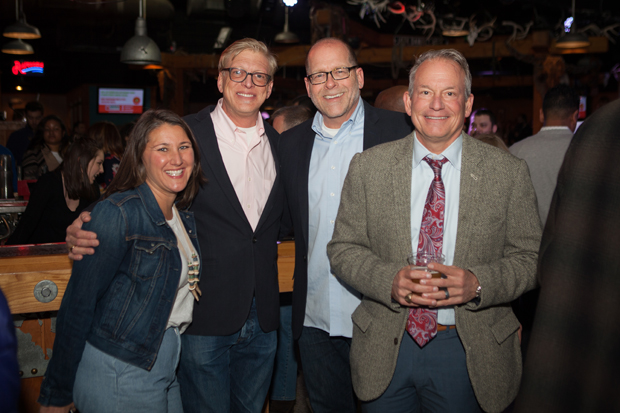 Christie Walsh-Myers, far left, the vice president of The Baltimore Station's board of directors, enjoys The Baltimore Station's 26th annual Homerun for Recovery fundraiser with William Runnebaum and Bill Mangham of Marcus-Boyd Realty and Michael Myers, a partner with RK&K.