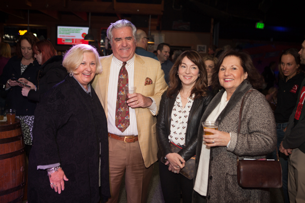 From left, Pamela Stevens; Lou Kousouris Jr., vice president with the Baltimore Orioles; Jenny Kousouris; Connie Rogers, of Camp Puh'tok, take time for a photo during The Baltimore Station's 26th annual Homerun for Recovery fundraiser.