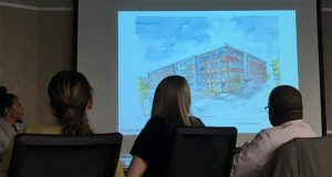 Members of Baltimore's Urban Design and Architecture Advisory Panel reviews schematics for an apartment building at 520 Somerset on Thursday. The project is the second building proposed for the former Somerset Courts public housing site by Henson Development Co. and partner Mission First Housing.  (The Daily Record / Adam Bednar)