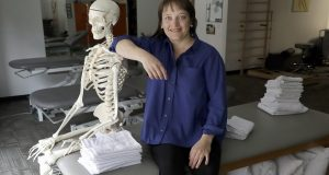 "In this Saturday, May 12, 2018, photo, April Oury, owner of Body Gears physical therapy center poses for a portrait with her instructional skeleton George, in Chicago. Oury started her physical therapy practice 14 years ago wanting to give all aspects of her business the same focus and attention to detail she gave patients, even when it came to choosing paint colors or an internet provider. She wouldn't do it that way again. ""There was not enough time in the day or the workweek to put that kind of effort into every single thing,"" says Oury. (AP Photo/Charles Rex Arbogast)"