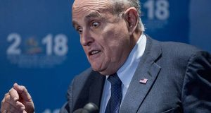Rudy Giuliani, an attorney for President Donald Trump, speaks to reporters after speaking at the Iran Freedom Convention for Human Rights and democracy at the Grand Hyatt, Saturday, May 5, 2018, in Washington. (AP Photo/Andrew Harnik)