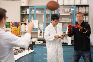 Matt Furstenburg, Chief Executive Officer of Grip Boost, helps test a new formula for their clean tacky football gel in the lab.