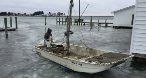 Scott Robinson Sr. brings his boat in after a morning of winter harvest for Madhouse Oysters. (Submitted photo)