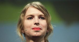 "FILE- In this May 2, 2018, file photo, Chelsea Manning attends a discussion at the media convention ""Republica"" in Berlin. A close friend and colleague of Chelsea Manning said Monday, May 28, that the convicted leaker of government secrets and longshot candidate for U.S. Senate is safe after a photo on her Twitter account apparently showed the 30-year-old woman standing on the edge of an upper-story window ledge. (AP Photo/Markus Schreiber, File)"