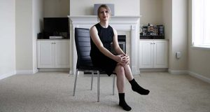 In this April 24, 2018 photo, Chelsea Manning poses for a photograph in her apartment in North Bethesda, Md. It's one of the most unconventional U.S. Senate bids in recent memory: Manning, America's most famous convicted leaker, is seeking to win Maryland's Democratic primary. (AP Photo/Patrick Semansky)