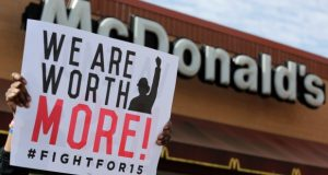 McDonald's workers and supporters rally outside a McDonald's in Chicago in April 2015. Fight for $15 announced Tuesday it's helping women in several U.S. cities to file complaints with the U.S. Equal Employment Opportunity Commission alleging they experienced sexual harassment while working at McDonald's. (M. Spencer Green/AP file photo)