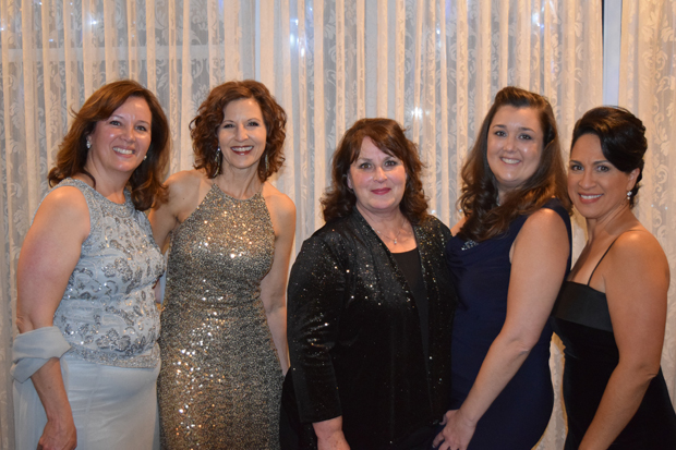 From left, Aberdeen Proving Ground Federal Credit Union colleagues Liz Leoni-Monti, financial education director; Susan Kemen, chief operations officer; Claudia Holman, business development director; Joelle Hash, vice president, branch operations; and Alicia Figueroa, area manager, gather for a photo during The Arc Northern Chesapeake Region's 14th annual After d'Arc Gala. APGFCU was the title sponsor of the gala. (Photo courtesy of The Arc Northern Chesapeake Region)