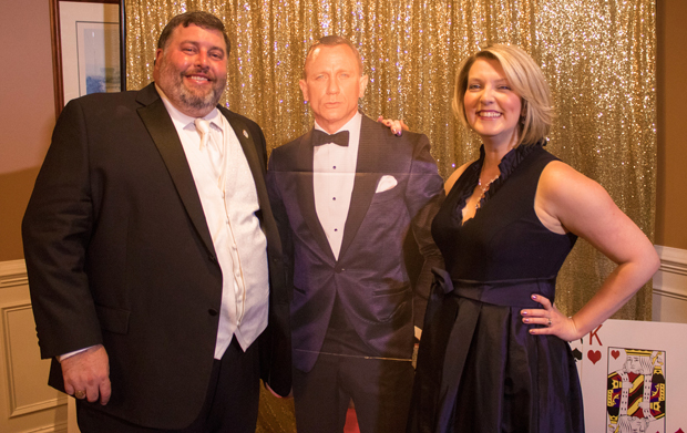 "Len Parrish, left, the director of housing and community development for Harford County, and Andrea Harkins Parrish, an assistant professor and graduate program director at Towson University, have some fun at The Arc Northern Chesapeake Region's 14th annual After d'Arc Gala by getting a photo with ""James Bond,"" Daniel Craig.  (Photo courtesy of The Arc Northern Chesapeake Region)"