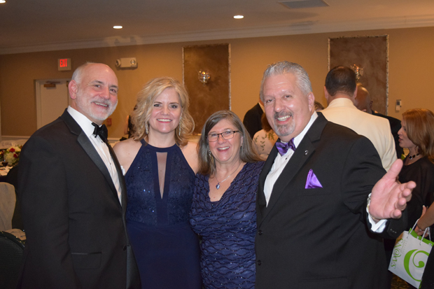 From left, Eric Rebbert, president of Express Employment Professionals - Harford & Cecil Counties and Stacey Rebbert, marketing manager with Harford Mutual Insurance, spend time with Denise and Mark Dardozzi, co-owner and vice president of Richlin Catering & Events Center, during The Arc Northern Chesapeake Region's 14th annual After d'Arc Gala. (Photo courtesy of The Arc Northern Chesapeake Region)