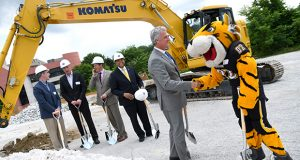 Brian Gibbons, CEO and chairman of Greenberg Gibbons, which is the owner and acting managing partner of Towson Row, shakes hands with the Tiger mascot from Towson University after the restarted project's second groundbreaking ceremony (The Daily Record/Maximilian Franz)