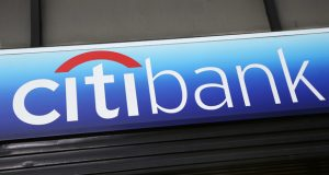 FILE - In this Jan. 15, 2015, file photo, a Citibank sign hangs above a branch office in New York. On Tuesday, Jan. 16, 2018, Citigroup Inc. reports financial results. (AP Photo/Mark Lennihan, File)