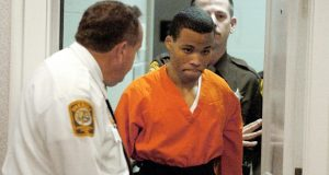 FILE - In this Oct. 26, 2004, file photo, Lee Boyd Malvo enters a courtroom in the Spotsylvania, Va., Circuit Court. Malvo, a sniper serving life in prison for terrorizing the Washington, D.C., region as a teenager must get new sentencing hearings in Virginia, a federal appeals court ruled Thursday, June 21, 2018.  (Mike Morones /The Free Lance-Star via AP, File)