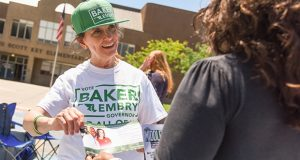 6-26-18 BALTIMORE, MD- Mary Ann Mears, artist and mother of Elizabeth Embry, talks to Wendy Smith about her daughter who is running for Lt. Governor on Rusher Baker's ticket in the Democratic primary outside of Francis Scott Key Elementary/Middle School in Baltimore, MD.  Photo by Maximilian Franz