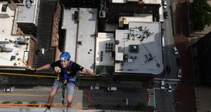 Ethan Harrison, a volunteer with Chai Lifeline, participates in the National Kidney Foundation's annual Rappel for Kidney Health fundraiser on Friday at 201 N. Charles St.  (The Daily Record / Maximilian Franz)