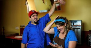 David and Laura Alima, founders of The Charmery, have some fun with sprinkles. (Photo Courtesy of Push to Start Inc.)