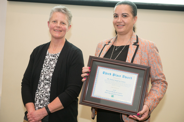 Donna Disney RN, BSN, left, and Dina A. Krenzischek, PhD, RN, MAS, CPAN, FAAN, FASPAN, right, display a third-place award received during the Sisters of Mercy Nursing Awards. (Photo by Jennifer McMenamin)