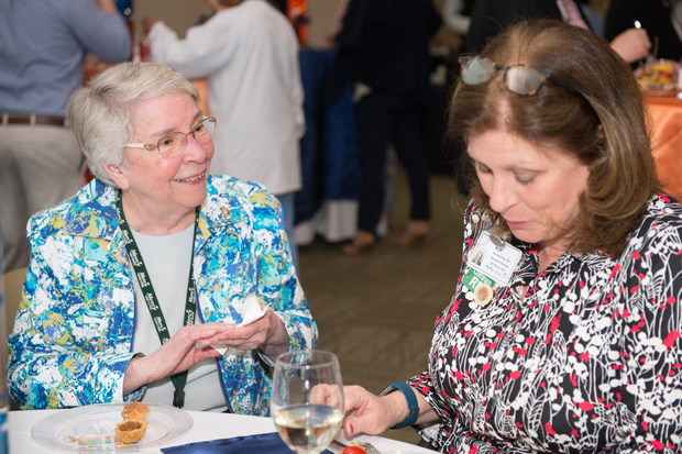 Sister Helen Amos, RSM, left, the executive chair of the Mercy Medical Center Board of Trustees chats with Kim Bushnell, DNP, RN, NEA-BC, vice president and chief nursing officer during the Sisters of Mercy Nursing Awards. (Photo by Jennifer McMenamin)