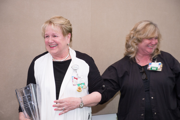 Connie Mackowiak, BSN, RN, left, walks away with the Nursing Leadership Award after a presentation from Sr. Elizabeth Anne Corcoran during the Sisters of Mercy Nursing Awards. (Photo by Jennifer McMenamin)