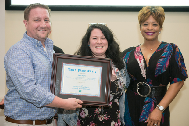 From left, David Lynch RN, BSN; Autumn Forester RN, BSN; and Shantelle Mobley RN, MSN display a second-place award received during the Sisters of Mercy Nursing Awards.
