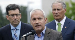 "Northwest Immigrant Rights Project Executive Director Jorge Baron, center, speaks as Washington Attorney General Bob Ferguson, left, and Washington Gov. Jay Inslee, look on at a news conference announcing a lawsuit against the Trump administration over a policy of separating immigrant families illegally entering the United States, in front of the Federal Detention Center Thursday, June 21, 2018, in SeaTac, Wash. Ferguson made the announcement outside the federal prison south of Seattle, where about 200 immigration detainees have been transferred — including dozens of women separated from their children under the administration's ""zero tolerance"" policy. (AP Photo/Elaine Thompson)"