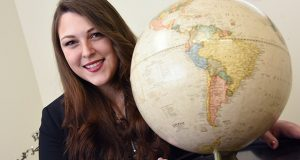 02.03.17 Towson, MD- Portrait of Nicole Whitaker, attorney, in her office with a globe displaying south America. MF